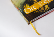 Hardcover book with printed cover and golden yellow bookmark