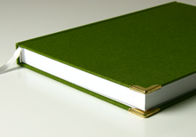 handmade book in green linen with book corners