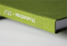 Green linen hardcover with white imprint