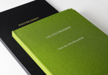 Hardcover books in linen green and black with embossed