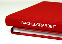 Bachelor thesis as a red hardcover book with embossing on linen